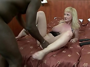 Blonde slut Monik blows a long black dong and fucks it in bed