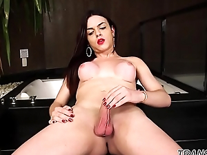 Bikini shemale wanks after stripping