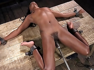 Ebony shocked with the addition of machine fucked