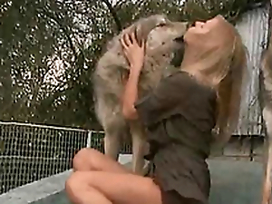 Horny and horny bit of skirt kisses a dog on the porch of the house